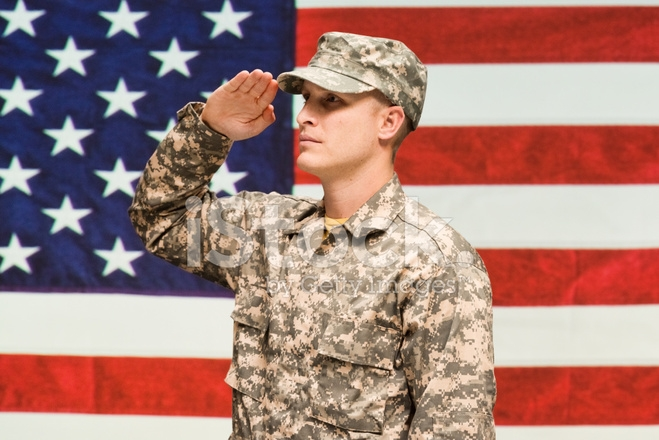 Cozy army man in front of american flag saluting stock photos American Army Man Pictures