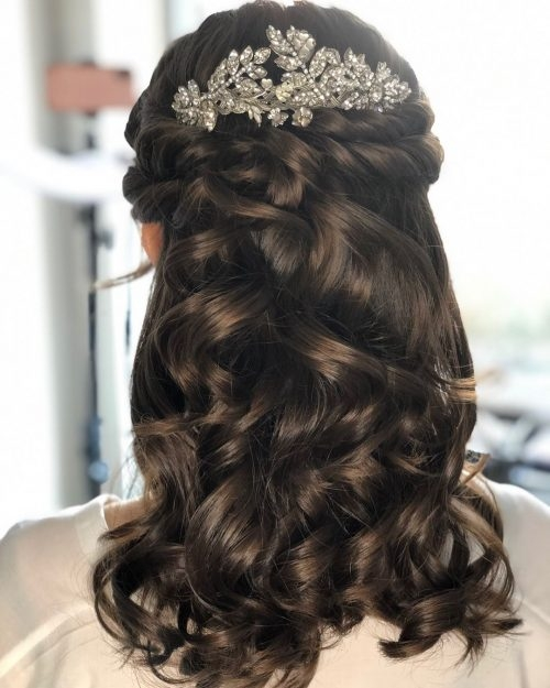 Stylish 27 prettiest half up half down prom hairstyles for 2020 Romantic Prom Hairstyle For Long Hair With Braided Flower Ideas