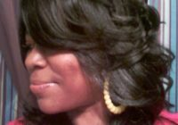 Elegant long layered and feathered wig hairstyle for black women Layered Haircuts For African American Hair Designs