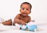 Stylish adorable little african american ba girl lying down Black American Baby Girls Ideas